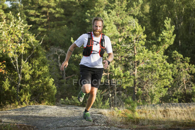 Man running through a forest — Stock Photo