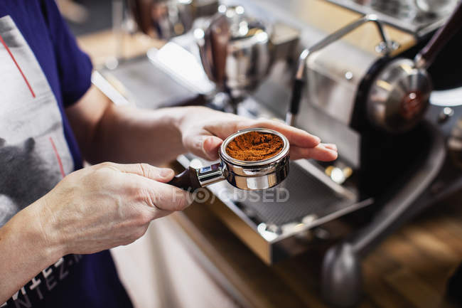 Barista making coffee, focus on foreground — Stock Photo