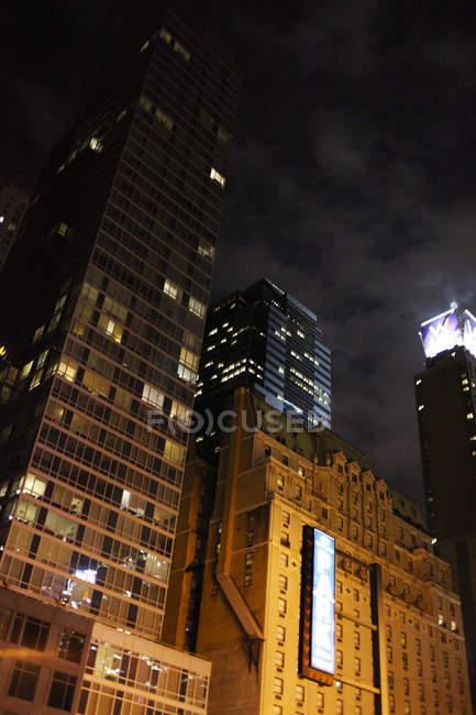 Illuminated skyscrapers at night, new york city — Stock Photo