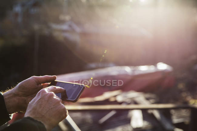Man using smart phone, focus on foreground — Stock Photo