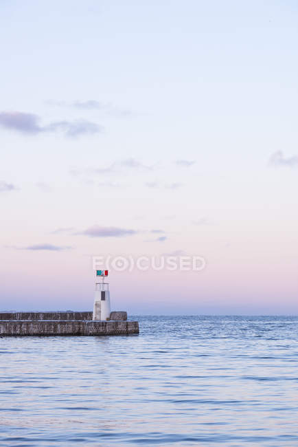 Scenic view of lighthouse on groyne at northern europe — Stock Photo