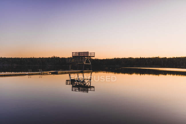Scenic view of wharf at lake at sunrise — Stock Photo