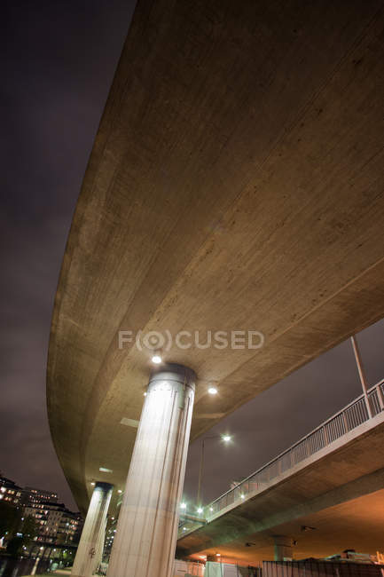 Low angle view of illuminated bridge at night — Stock Photo
