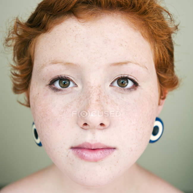 Portrait of young red hair woman looking at camera — Stock Photo