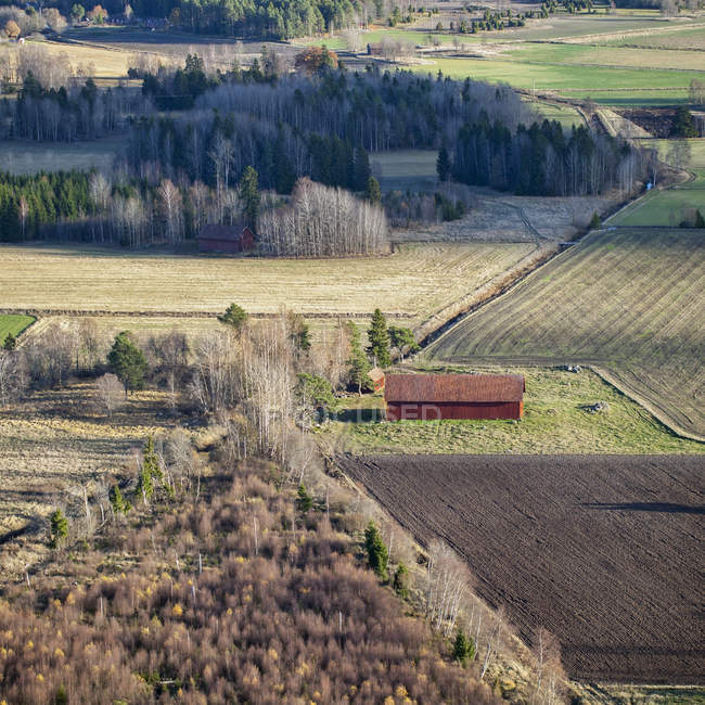 High angle view of barn and field in Karby, Sweden — Stock Photo