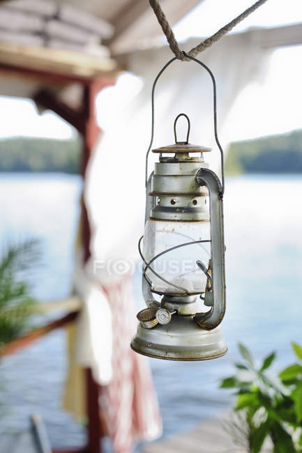 Oil lamp hanging from rope, focus on foreground — Stock Photo