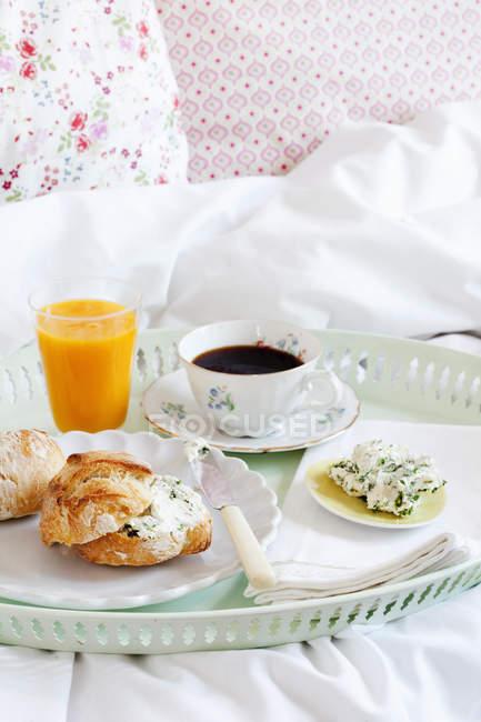 Breakfast on tray in bedroom, selective focus — Stock Photo