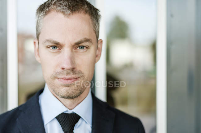 Portrait of mid adult businessman, focus on foreground — Stock Photo