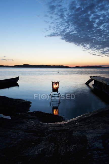 Lantern on lake at sunset, stockholm archipelago — Stock Photo
