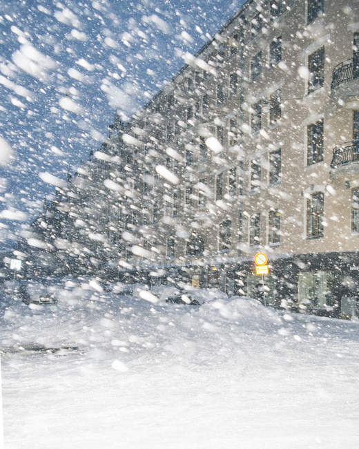 Illuminated building exterior at Helsinki in snowstorm, northern europe — Stock Photo