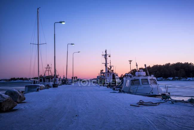 Boats anchored at marina at dusk, selective focus — Stock Photo
