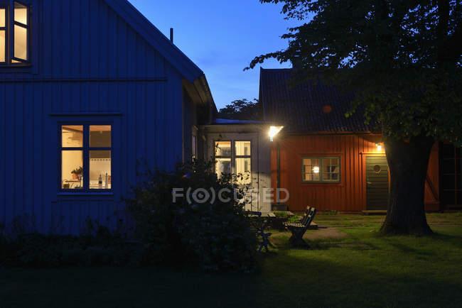 Illuminated houses at dusk, kingdom of sweden — Stock Photo