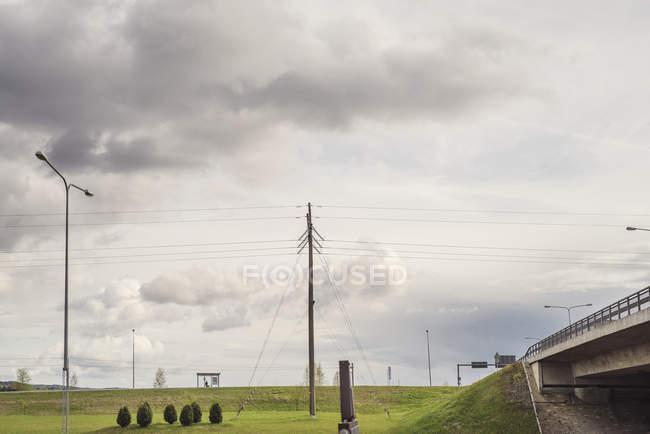 Overcast sky above green embankment, northern europe — Stock Photo