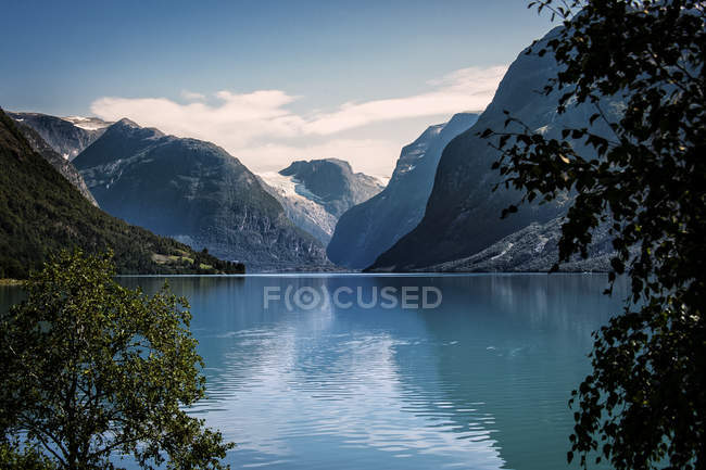 Scenic view of mountains reflecting in lake — Stock Photo