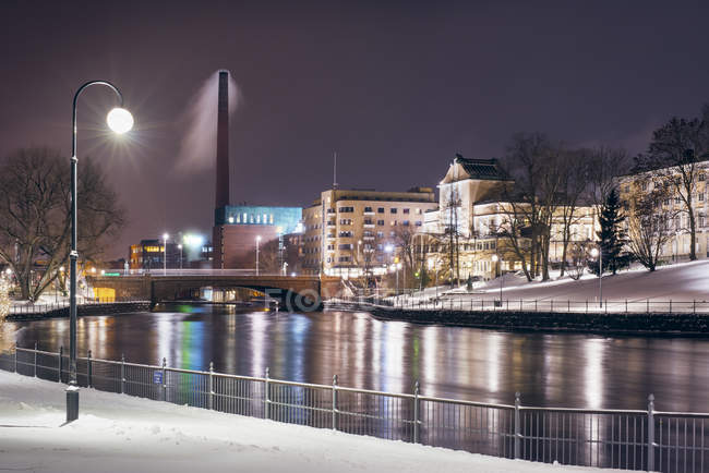 Urban scene with riverbank and street lights at winter — Stock Photo