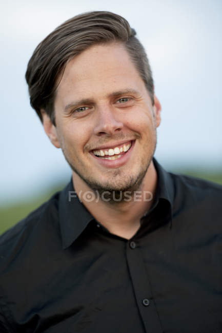 Portrait of man smiling outdoors, selective focus — Stock Photo