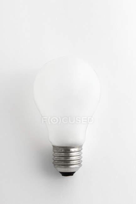 Studio shot of light bulb isolated on white background — Stock Photo
