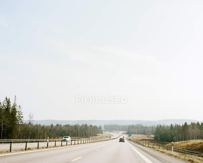 View of road with moving cars in daylight — Stock Photo