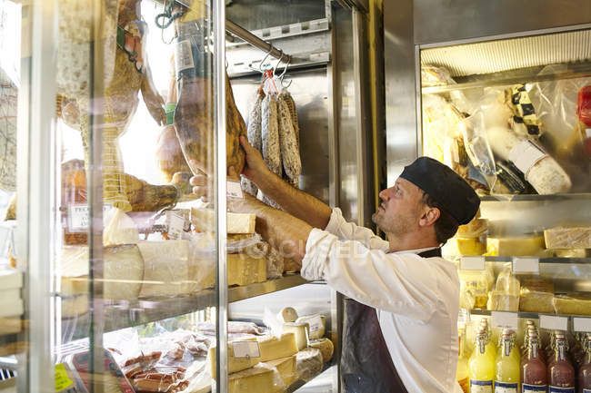 Side view of man working in food store — Stock Photo