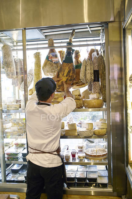 Rear view of man working in food store — Stock Photo