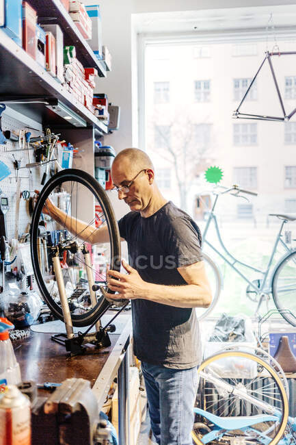 Small business owner of bicycle store — Stock Photo