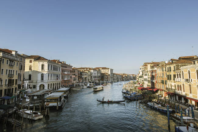 Canal in Venice with gondolas and boats — Stock Photo