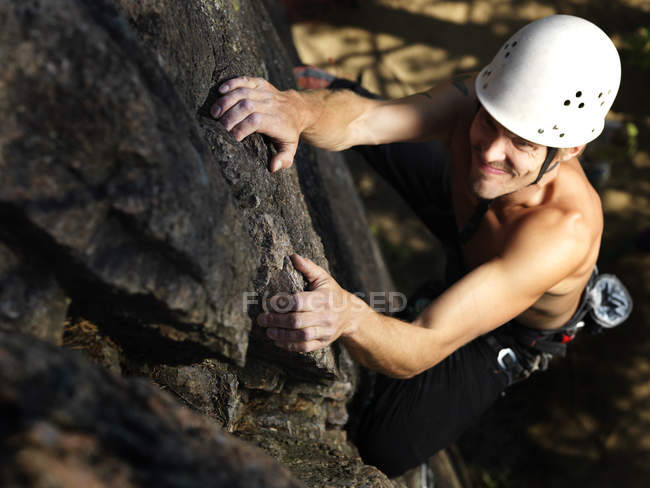 Elevated view of man climbing rock — Stock Photo