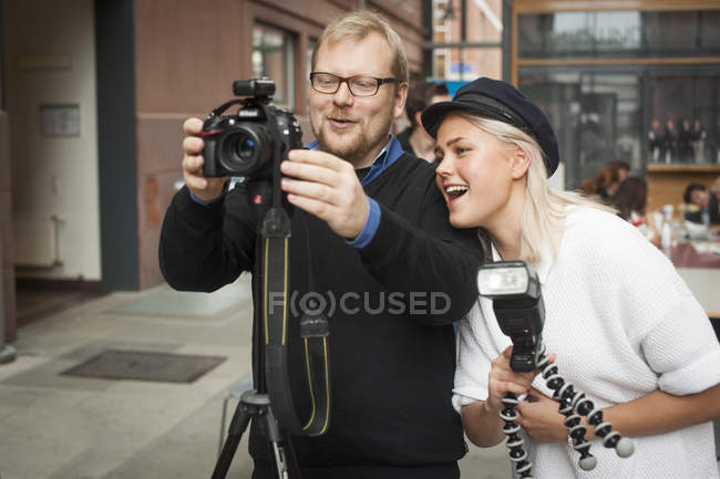 Woman and man photographing, focus on foreground — Stock Photo