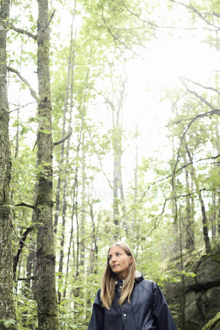 Cropped view of mid adult woman in forest — Stock Photo