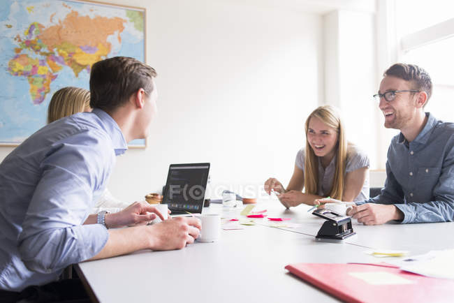 Business people laughing in board room — Stock Photo