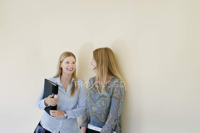 Female students communicating at university interior — Stock Photo