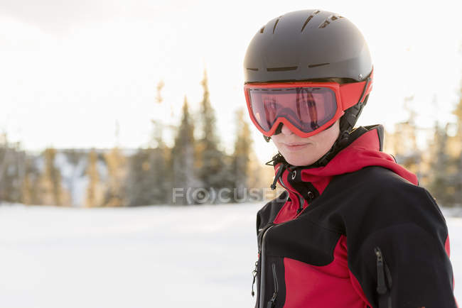 8f8913392fa Portrait of woman wearing helmet and ski goggles — Stock Photo