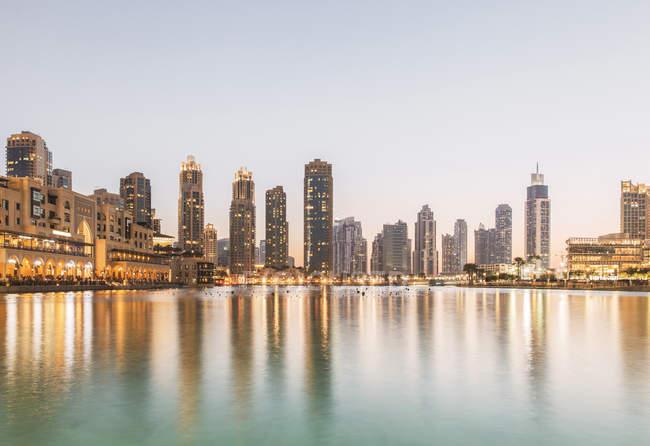 Scenic view of skyline at dusk in Dubai — Stock Photo