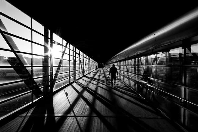 Silhouette of person walking by window in Vantaa, Finland — Stock Photo