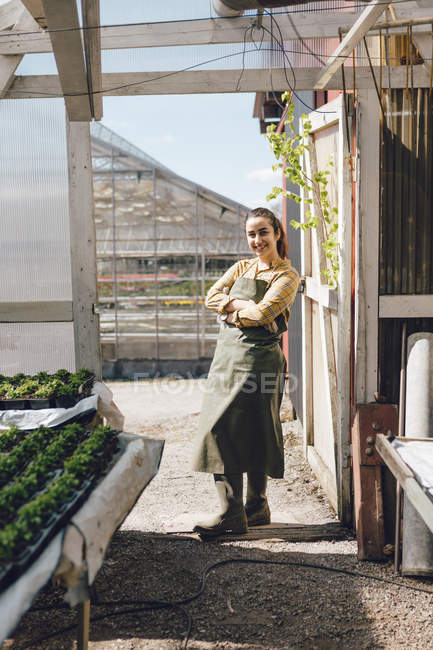 Portrait of garden centre worker in greenhouse, selective focus — Stock Photo