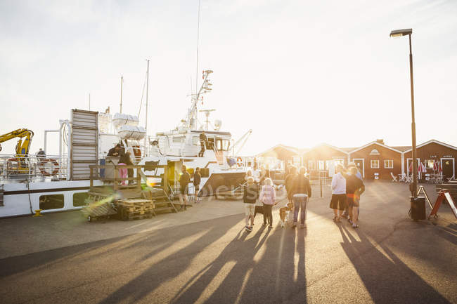 People walking at sunset at Hano harbor in Sweden — Stock Photo