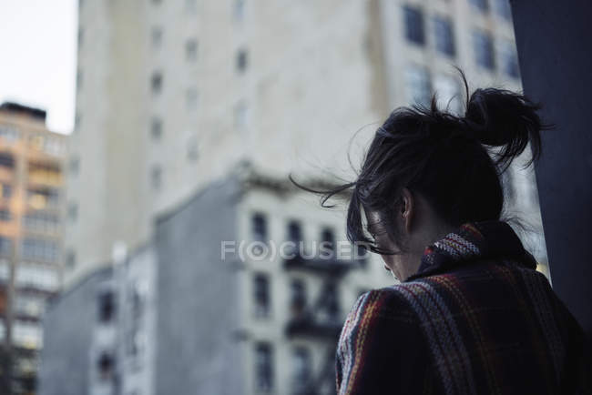 Young woman standing at street, selective focus — Stock Photo