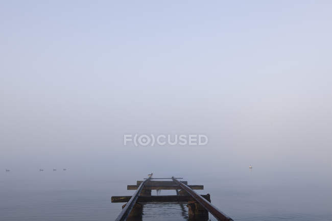 Railway track into sea in Kampinge, Sweden, selective focus — Stock Photo