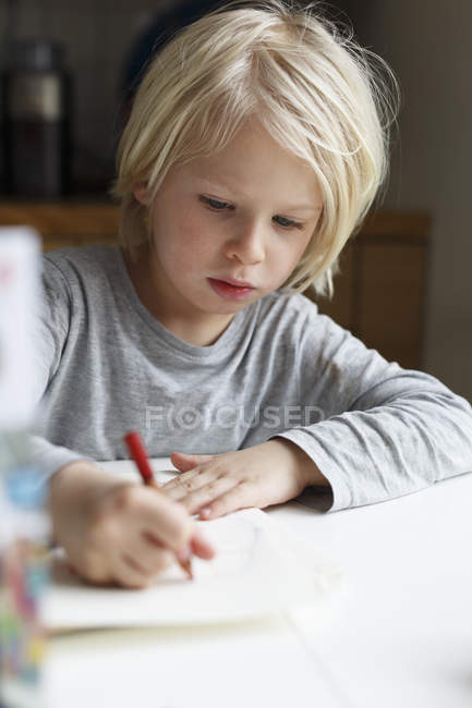 Boy drawing at table, selective focus — Stock Photo