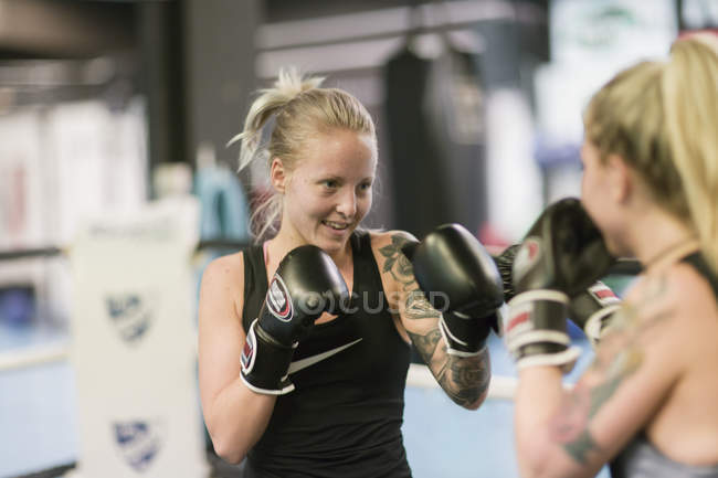 Two women sparring in boxing class, selective focus — Stock Photo