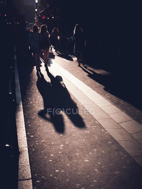 People walking down city street in Paris, France — Stock Photo