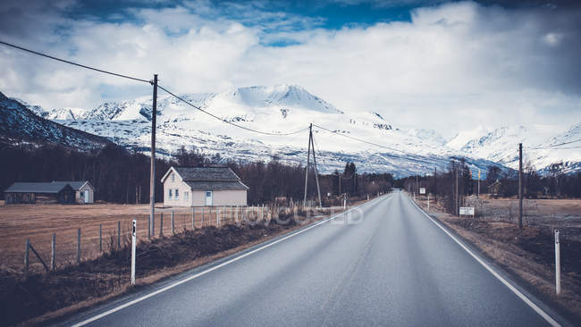 Rural road by mountain in Storfjorden, Norway — Stock Photo