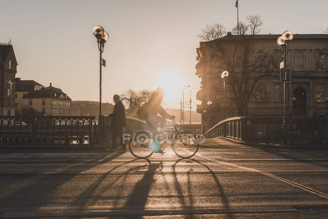 Man bicycling at sunset in Stockholm, Sweden — Stock Photo