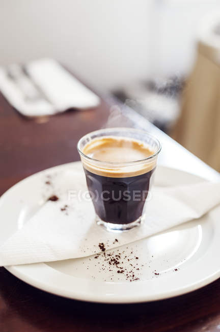 Espresso coffee on plate, soft focus background — Stock Photo