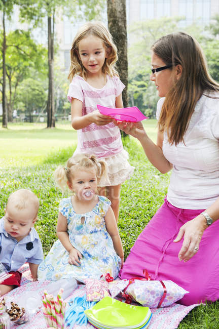 Mother with children at birthday picnic, selective focus — Foto stock