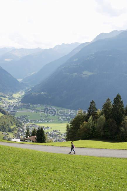 Girl walking along rural road in Vorarlberg, Austria — Stock Photo