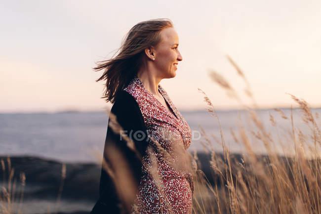 Smiling woman relaxing at beach in Blekinge, Sweden — Stock Photo