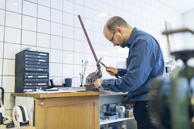Goldsmith working with hammer at workshop, selective focus — Stock Photo