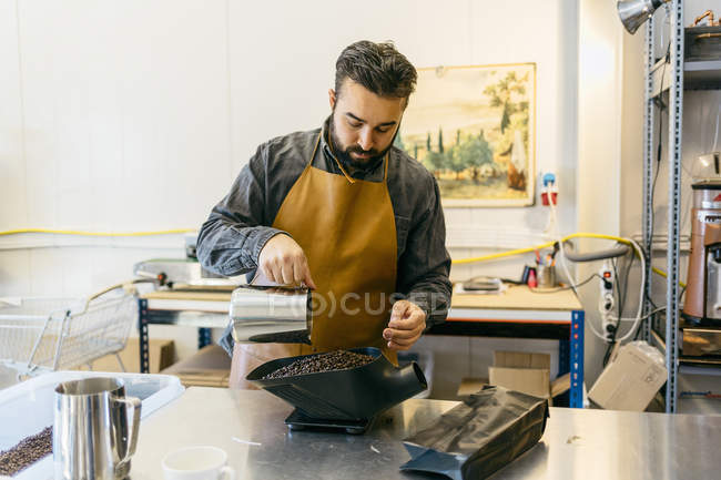 Small business owner working at coffee roaster shop — Stock Photo