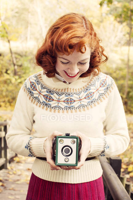 Woman holding vintage camera, focus on foreground — Stock Photo